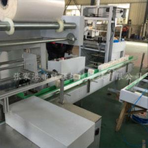 闸门直线式膜包机 厂家直销新胜强 饮料瓶 自动热收缩膜包机