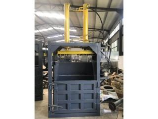 新款油漆桶压扁机-废纸箱书本打包机生产厂家